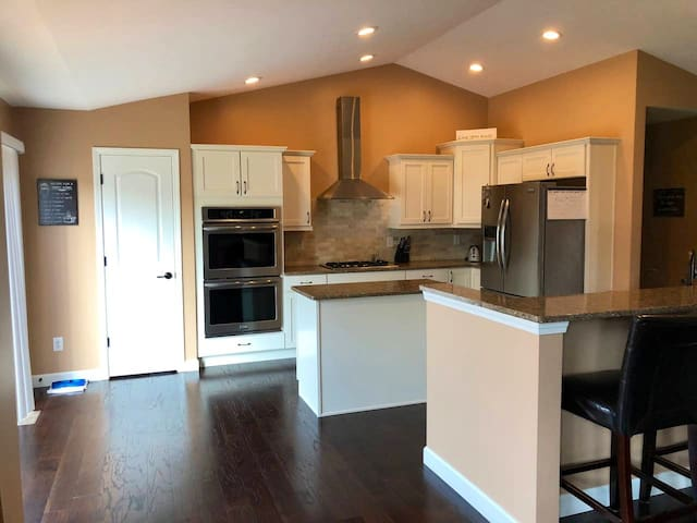 Large open concept kitchen , microwave, double ovens and bar top seating as well