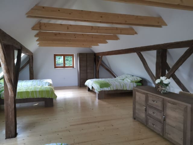 bright spacious  bedroom with 5 comfortable beds