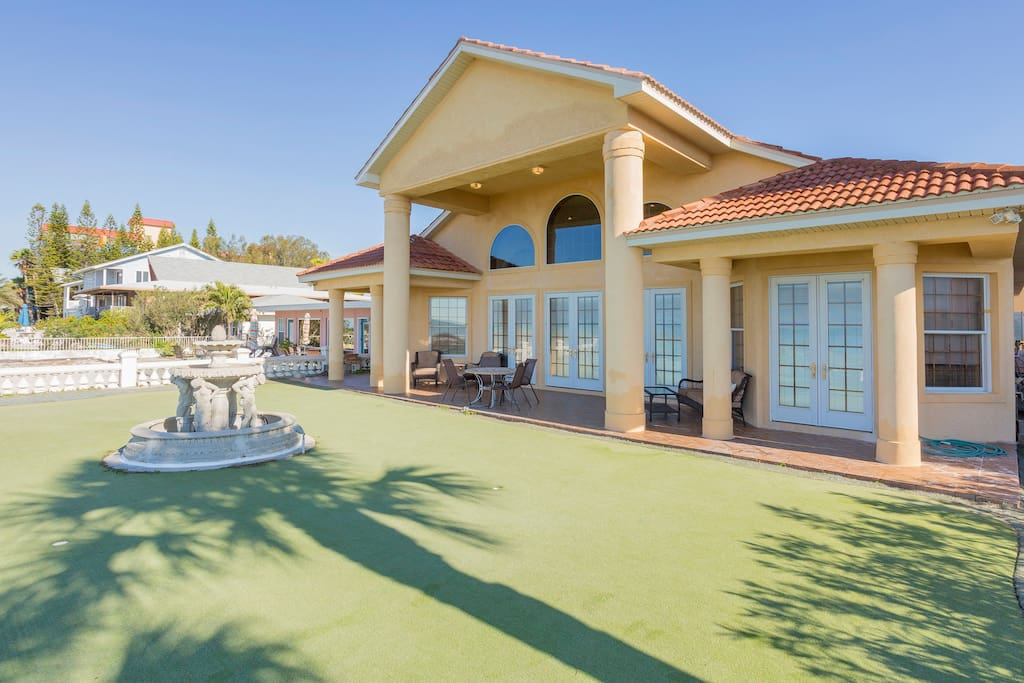 Sharpen your putting skills on your private putting green overlooking the beach.