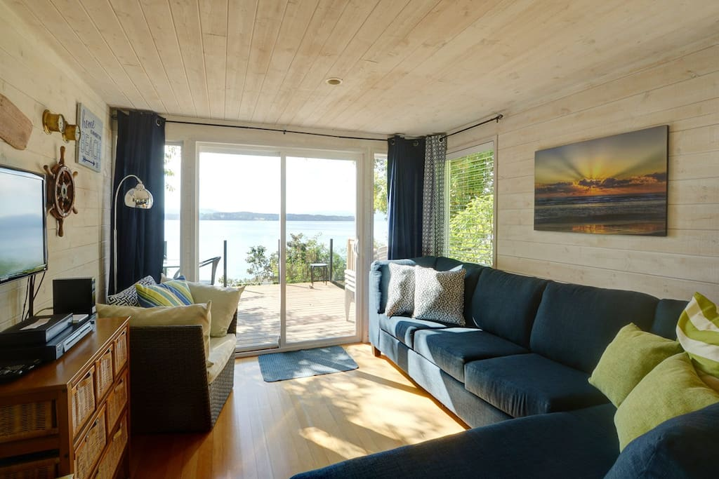 Living Room With Deck Access And Ocean Views.