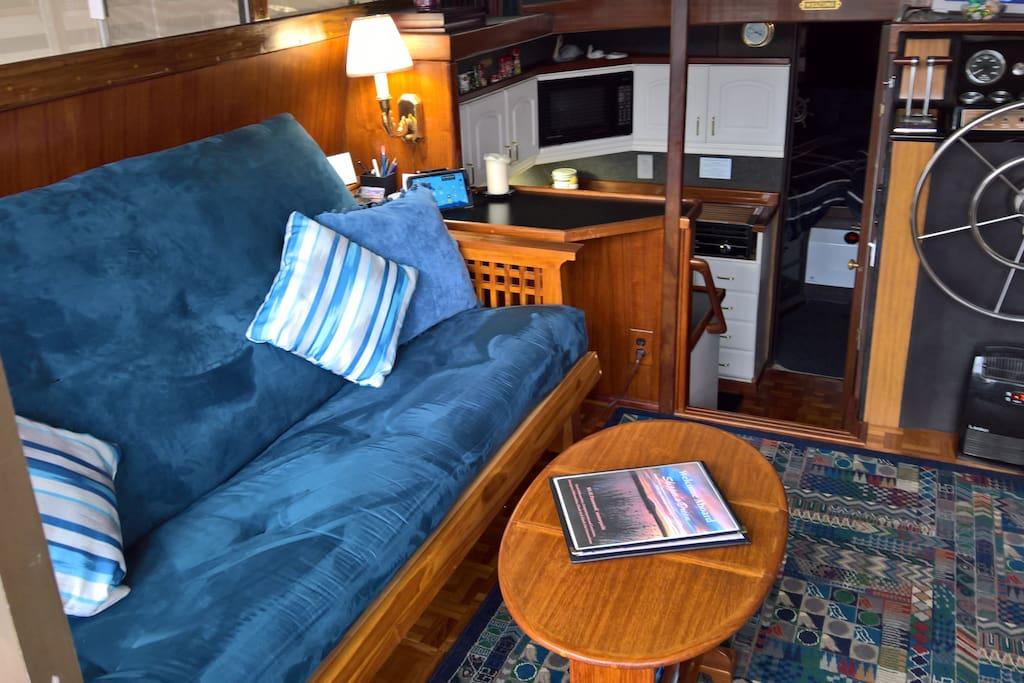 eak furnished Salon, Port side, viewed looking forward from the Cockpit.