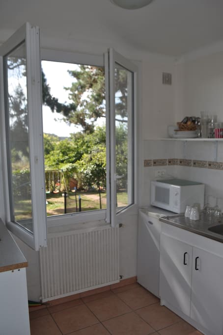 separate kitchenette overlooking beautiful trees and large garden