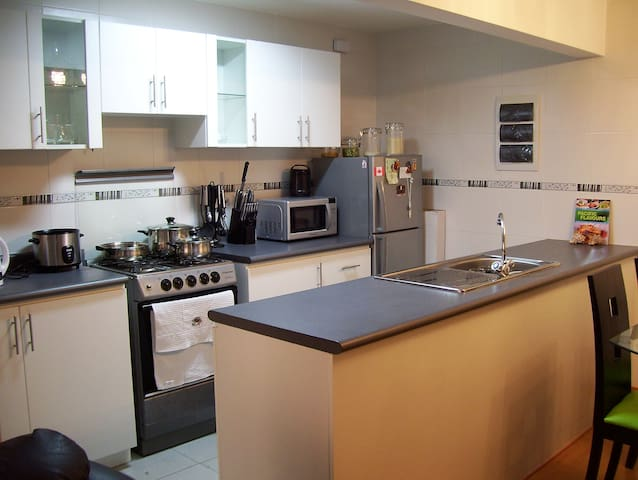 Bright, fully equipped, open-concept kitchen, all stainless steel appliances... everything you need to feel at home