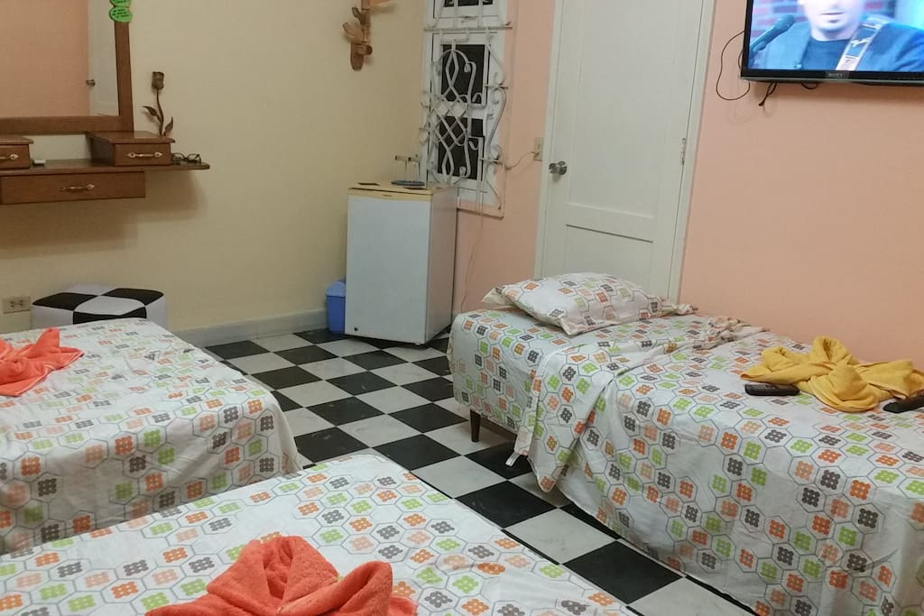room with three big beds for friends and family.
