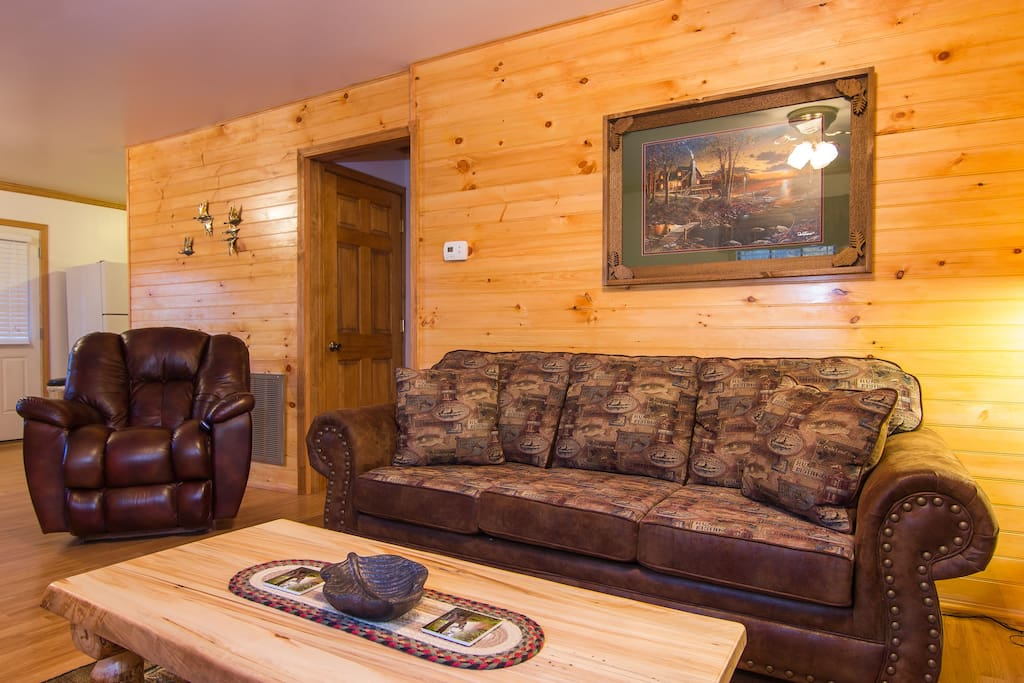 Living Room With A Pull Out Sofabed, Aspen Log Tables, And A Very Comfy Electric Leather Reclining Chair.