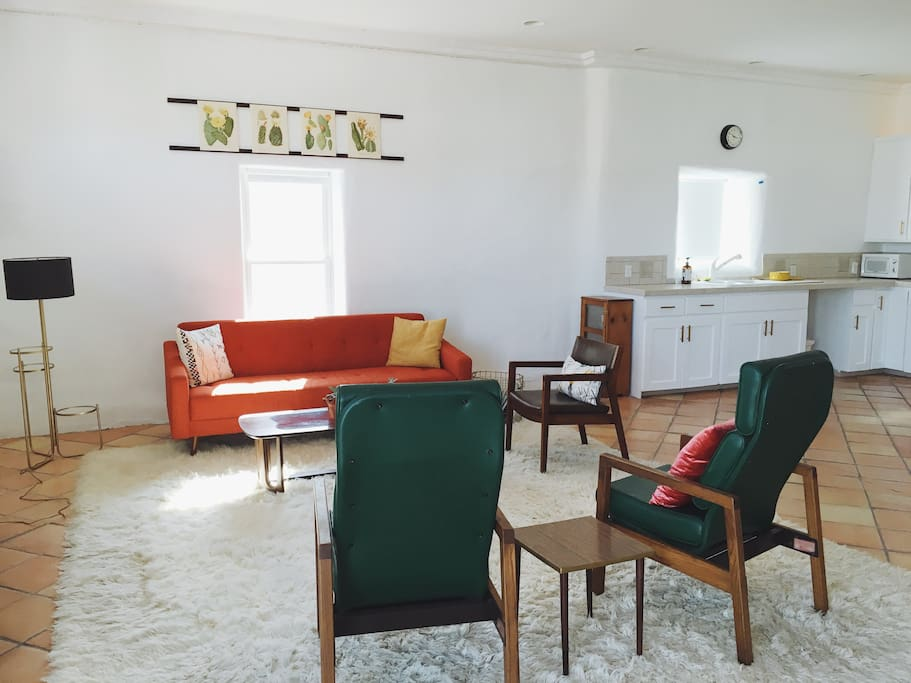 Big and bright: our living room, kitchen, and dining room are together in a big, beautiful space.