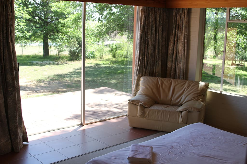 This room has a kingsize bed, with a beautiful view over grazing cattle.