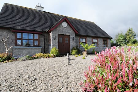 Architect designed house and award winning garden.