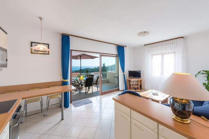 Kitchen, dining & living room area with exit to the sea view balcony