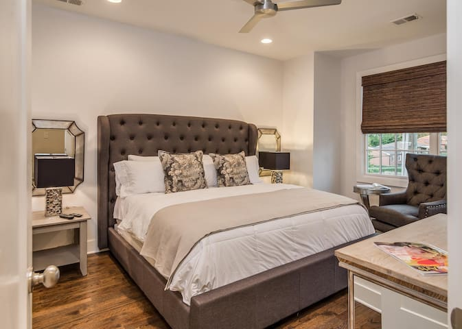 Relax in comfort and sophistication in the master bedroom on a king bed.
