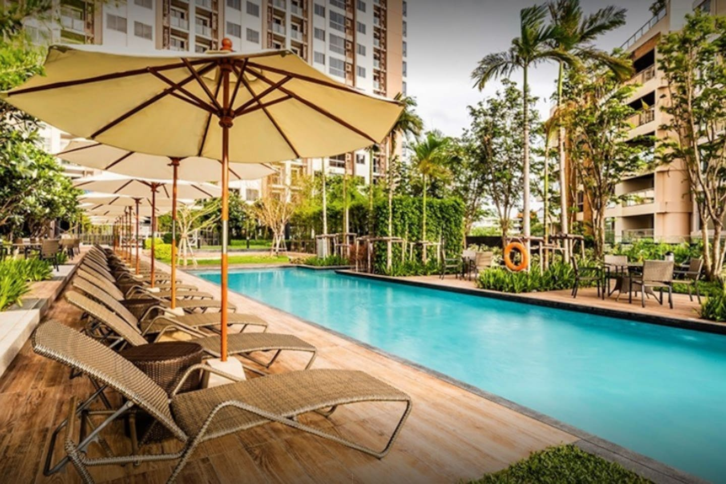 Apartment at a luxury condo featuring 5-star services including an amazing ground floor pool (see pic) with jacuzzi, climbing and huge slider ideal for kids and grownups alike.