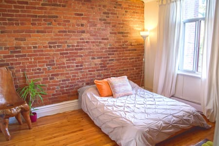 One Beautiful Bricked Plateau Room!