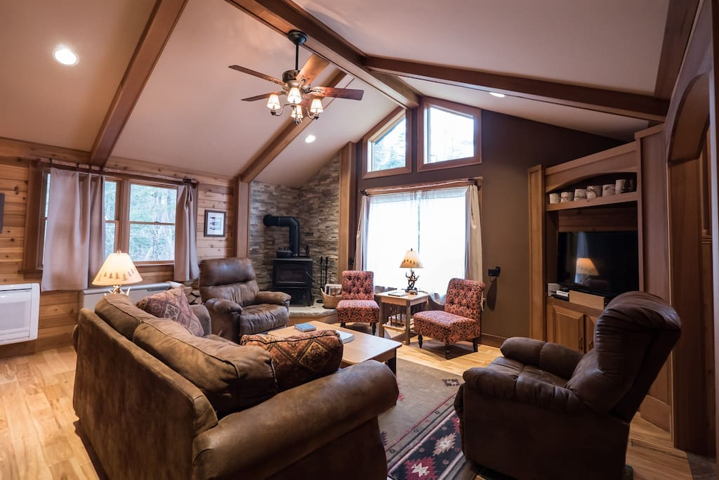 Living Room with wood stove and large TV/surround sound stereo system