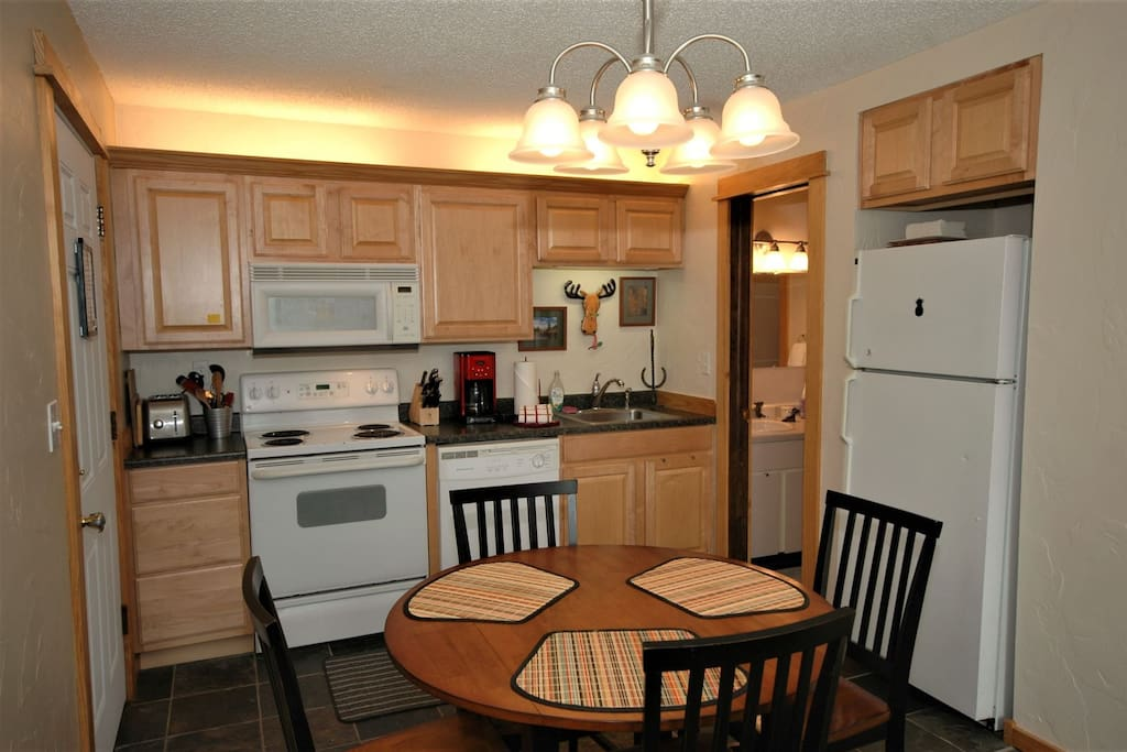 Full kitchen with full sized stove, dishwasher and all the comforts for the chef