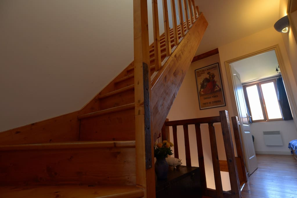 First floor landing with stairs up to the mezzanine