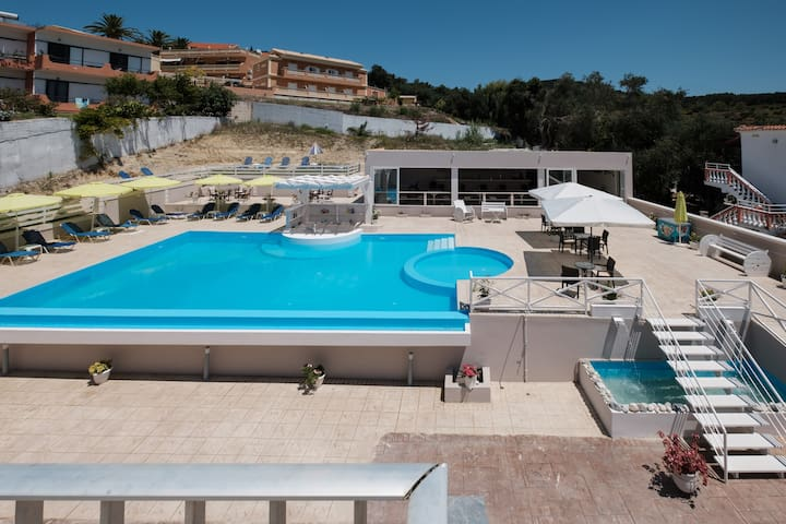 Corfu kouros studios with pool, near the beach