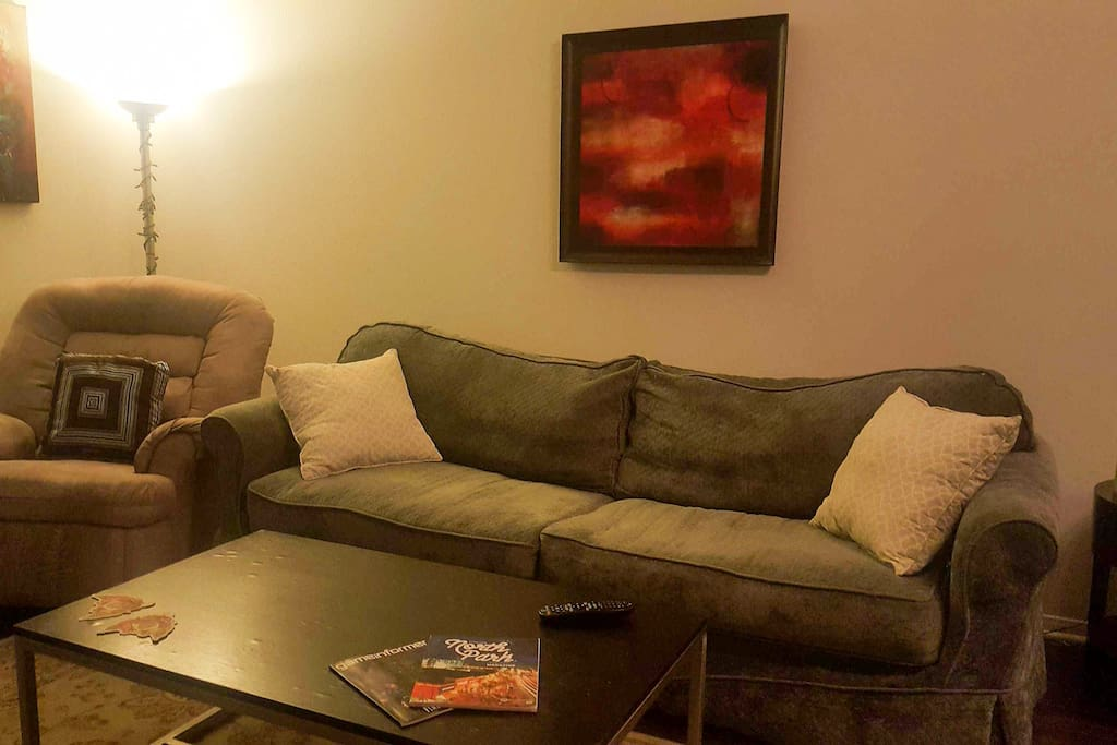 Comfortable living room with 4 person couch, lazy boy and 2 person love seat.