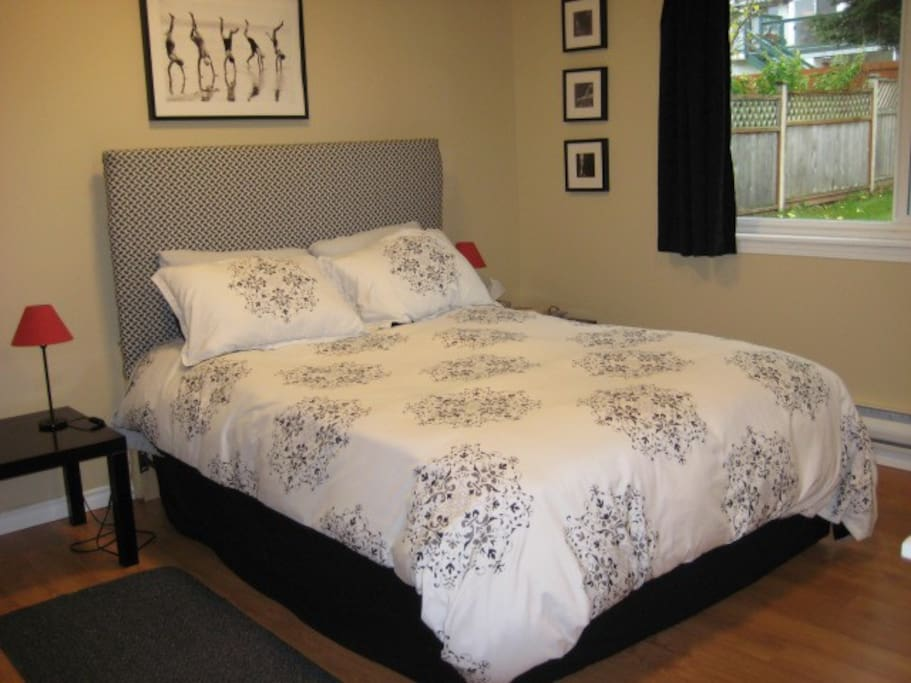 Bedroom with queen bed, down comforter and featherbed. Hypoallergenic bedding available on request.