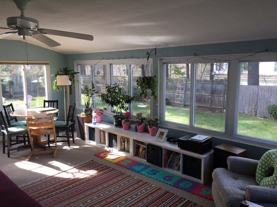 4-season sunroom with queen size sleeper sofa