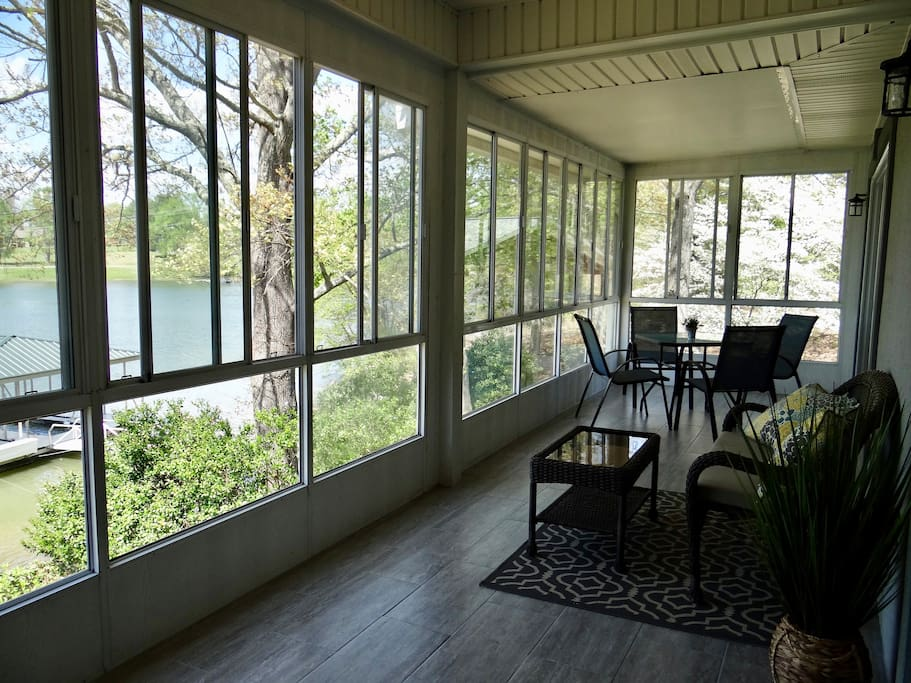 Another view of upper porch. Sunroom has screens to let the lake breeze flow in.