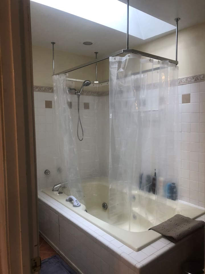 Hand-held shower w/adjustable settings