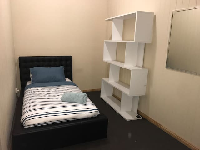 Great room & price close to the City and Airport