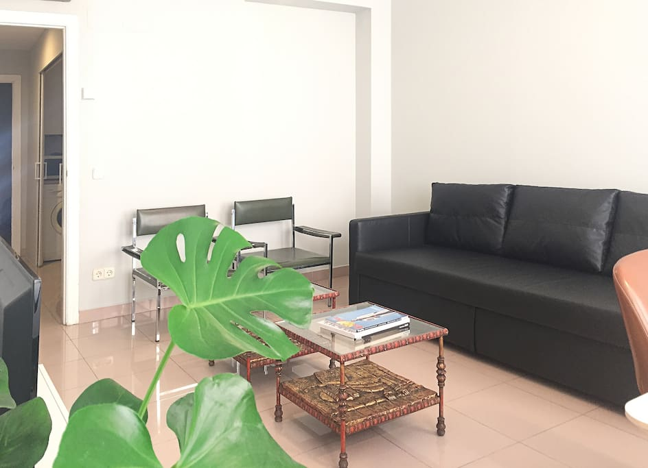 big living-room with sofa-bed and 70´s spanish design armchair