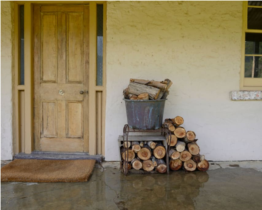 Front entrance with wood stacked for your open fire.