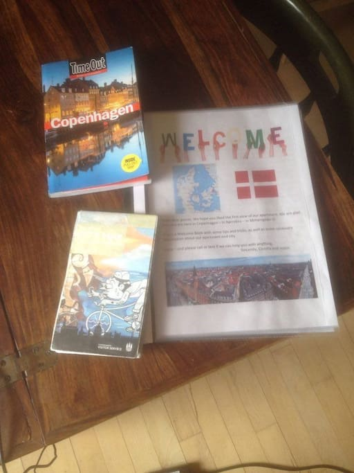 Our homemade welcome book to our guests with tips and tricks + a city map and tourist book.