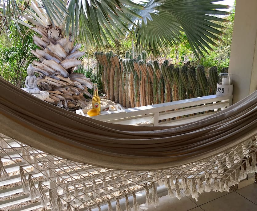 Relax in your hammock just in front of your entrance!