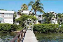 View from our dock on Sarasota Bay! The Cozy Bungalow is the top middle bungalow.