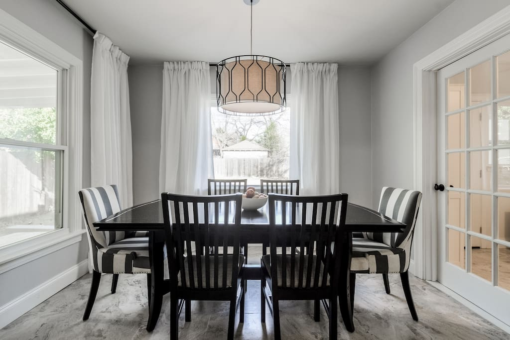 Spacious dining room that looks out over the back yard- we have extra chairs for groups of 8