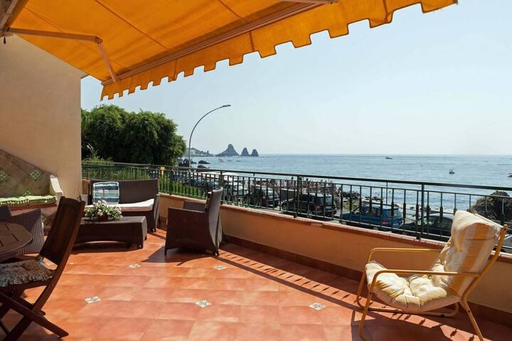 Beachfront balcony Aci Castello