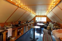 Each glamping tent has a kitchenette with compact fridge, sink, cabinets and hot plate.  Charcoal grills are outside.