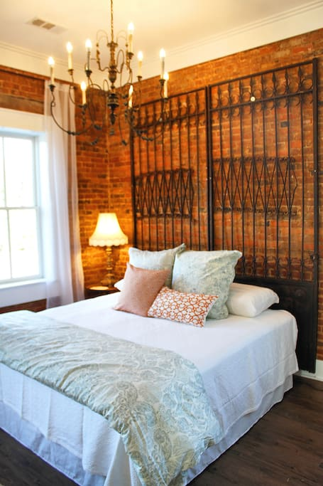 The headboard are wrought iron gates from an old South Georgian estate.