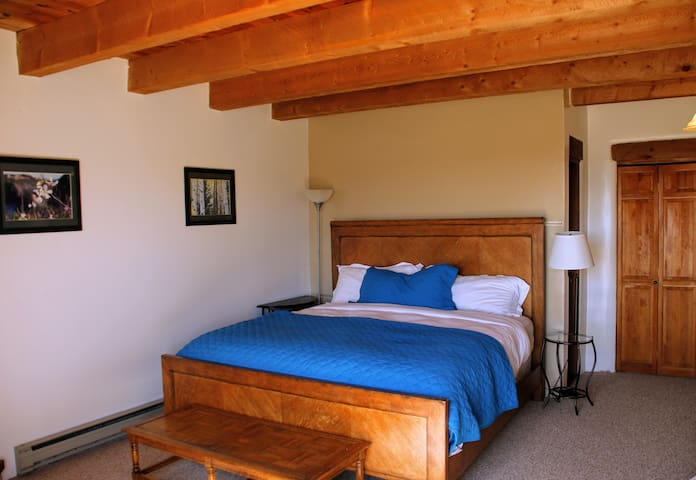 3rd floor includes a king bed, bunkbed (2 twins), desk, private bath, fireplace, and balcony