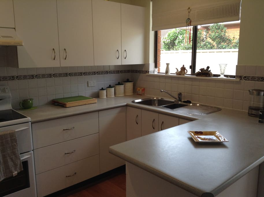 Clean, tidy, workable kitchen with microwave and dishwasher