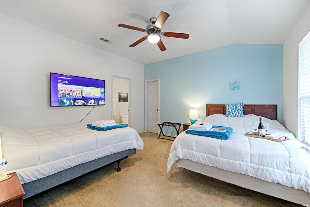 """Master Bedroom has 2 Queen Beds with headboards and a 55"""" Wall-Mounted 4K TV!"""
