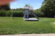 Use of swing set and sand box