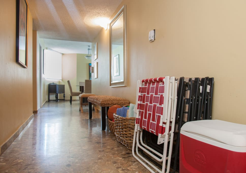 Elegant entrance, with beach towels and beach chairs ready to go.