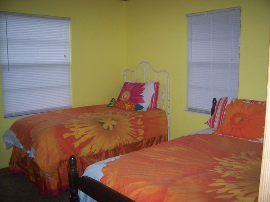 One bedroom with a double bed and twin bed
