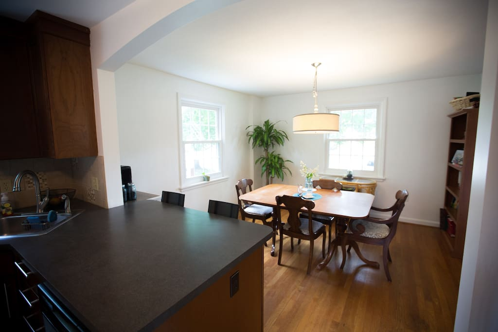 Dining room with bar seats and coffee nook.
