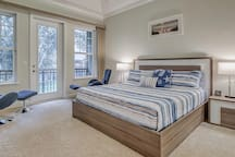 Master Bedroom - King Bed and Lounge Chairs with Ottomans
