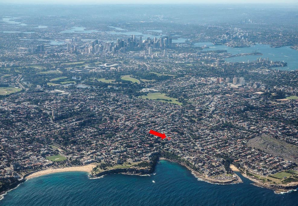 We're close to the beach, clifftop walks, and city. (Coogee Beach, Gordon's Bay and Clovelly Beach left to right in this pic.)