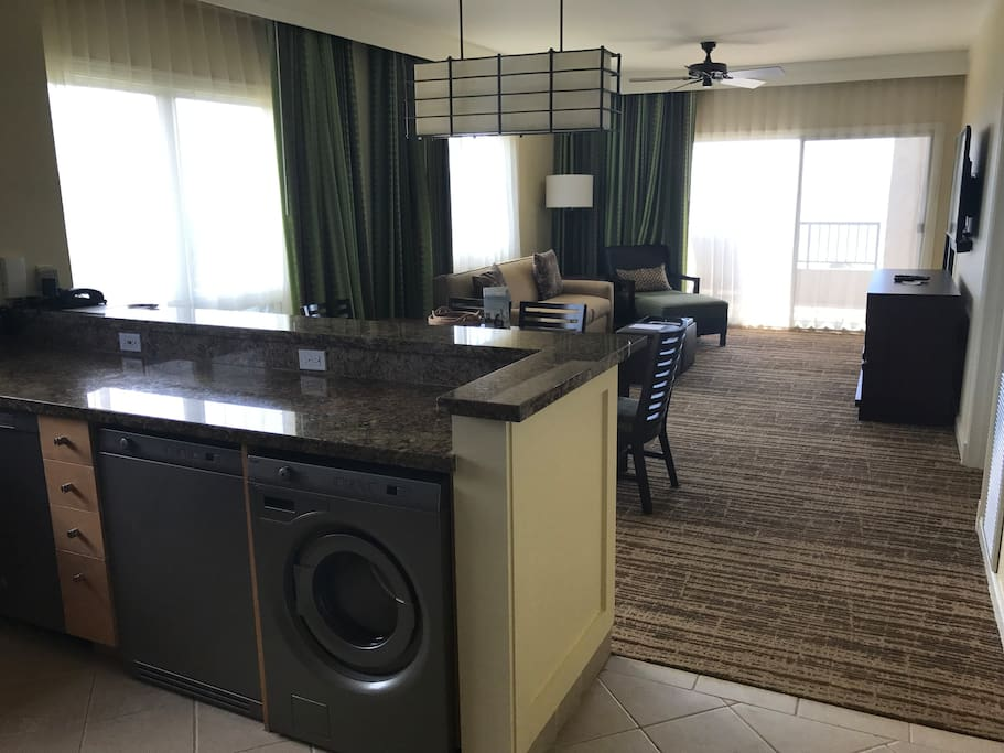 View from Kitchen to dining room and living room with washer and dryer