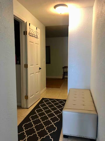 This hallway leads into the bathroom and bedroom