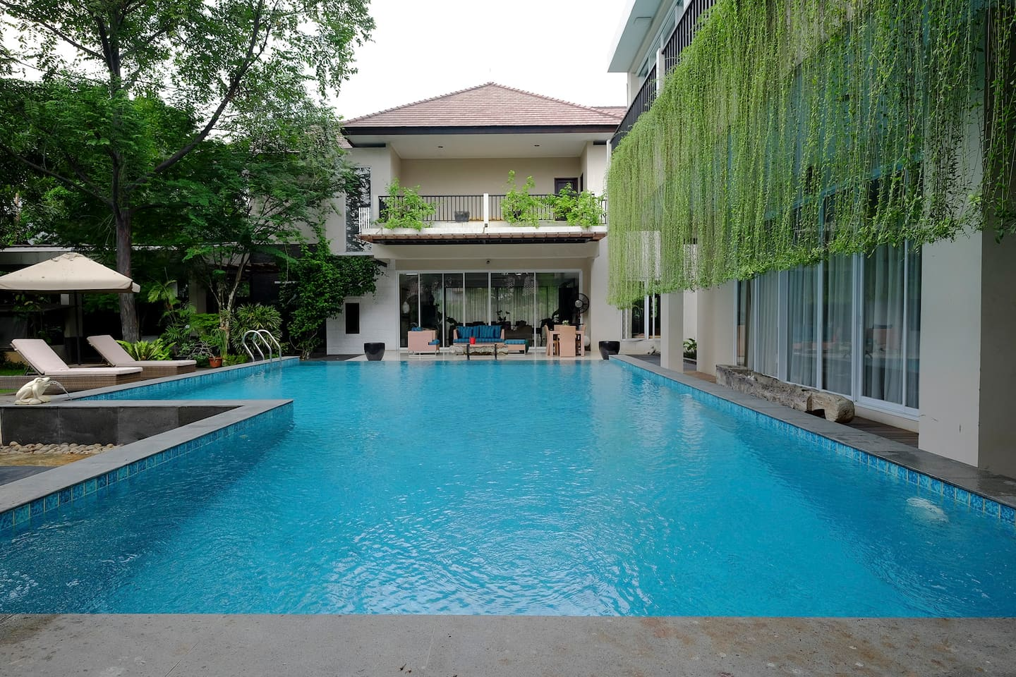 A serene 12-meter pool and deck in the backyard
