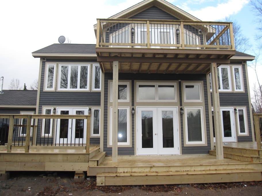 Large Front Decks with exceptional views of the golf course and landscape