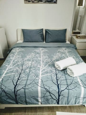 Queen size double, comfortable bed where you can enjoy your sleep after a busy day to the city
