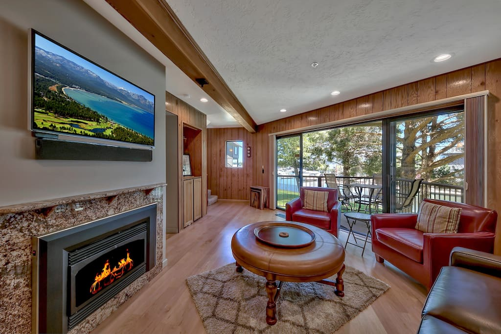 Relax in this living area with comfortable seating for 4, gas fireplace, large HDTV with cable